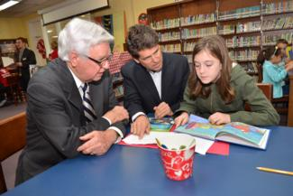 Rogers & Shriver read with local student